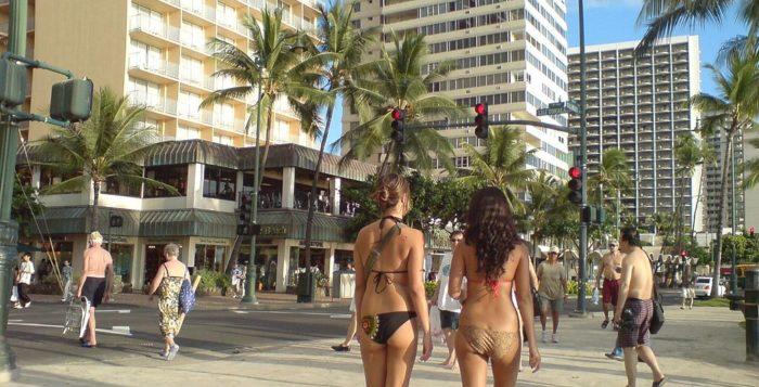 Beach goers walking along Waikiki street