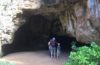 a family at the mouth of a cave