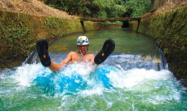 a man tubing in a flume