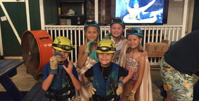 a group of children with helmets on