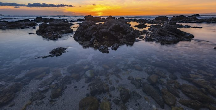 Sunset with tide pools in the foreground