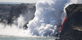 Lava hose shooting into ocean