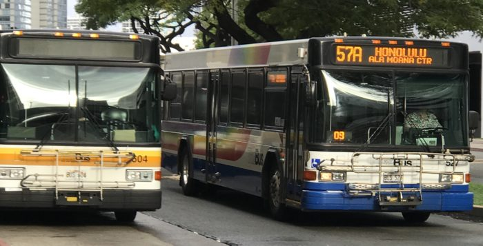 Two city buses on street