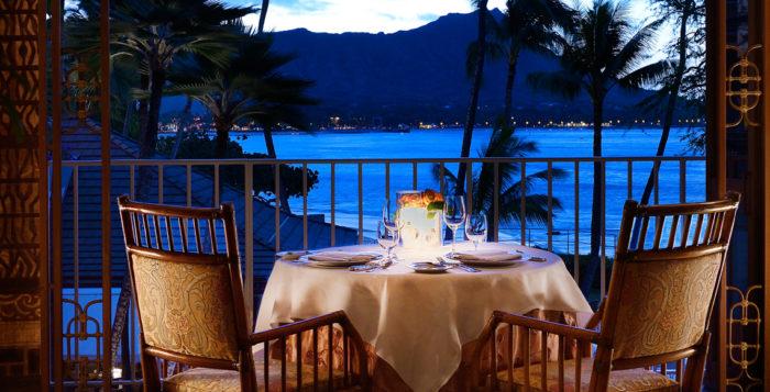 a table on a balcony by the ocean