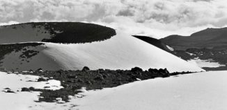 Snow capped cinder cones on top Mauna Kea
