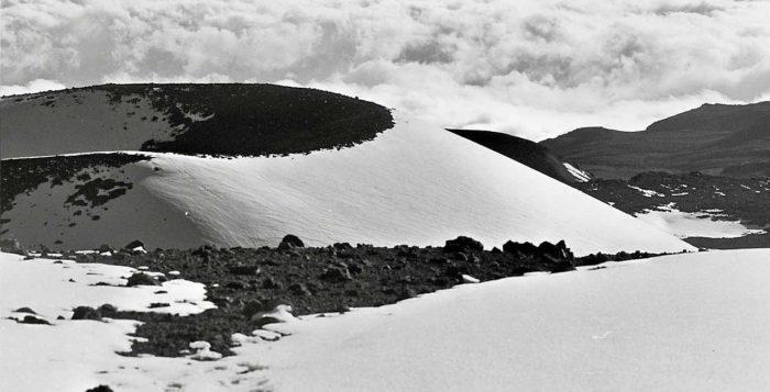 Snow capped cinder cones on top Mauna Kea