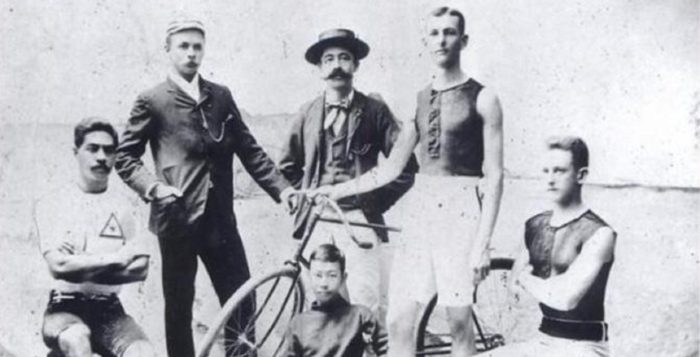 a group of men, including price kuhio, and a bicycle