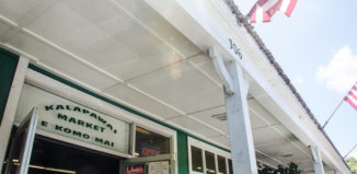 The entrance to Kalapawai Market in Kailua says E Komo Mai, which means welcome in Hawaiian.