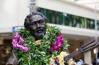 "A statute of Philip Kunia ""Gabby"" Pahinui has been immortalized in bronze by master sculptor Kim Duffett. It is located at Waikiki Beach Walk."