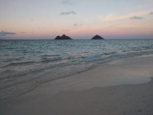 Lanikai Beach in the evening. You don't get to see the sunset, but the sky changing colors behind the Mokulua Islands is an incredible sight.