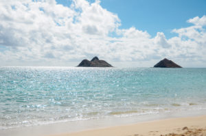 The view of the Mokulua Islands from Lanikai Beach. You can kayak to Moku Nui, the island on the left.