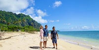 Couple and tour guide on the beach on Oahu